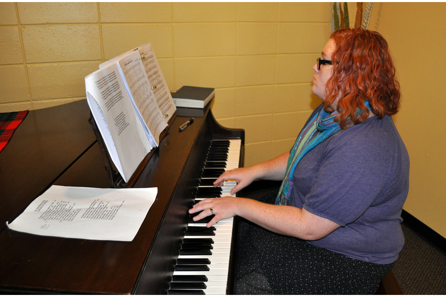 Lily Wohl played Christmas carols on the piano inside the Parish Hall.