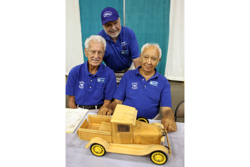 "Members of the Model ""A"" Restorers Club, Ed Greer, Joe Cunningham and Milton Rauch pose with Rauch's model."