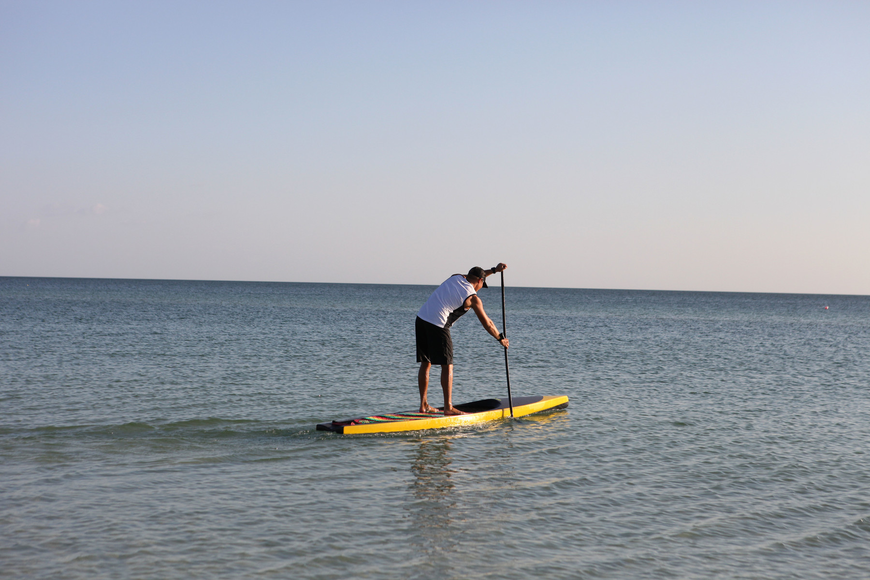 Brad Ward takes the first hour-long shift as he heads out into the Gulf of Mexico for the first hour of the 24-hour paddleboarding event Saturday, Oct. 13, at Siesta Key Public Beach.