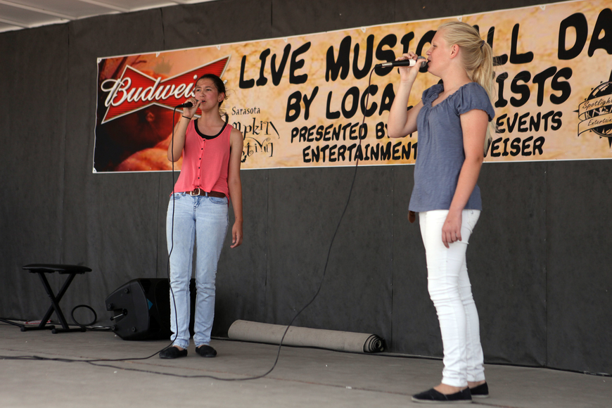 "Lilly Okland, 13, and Morgan Krikke, 13, perform ""For Good"" from the musical Wicked."