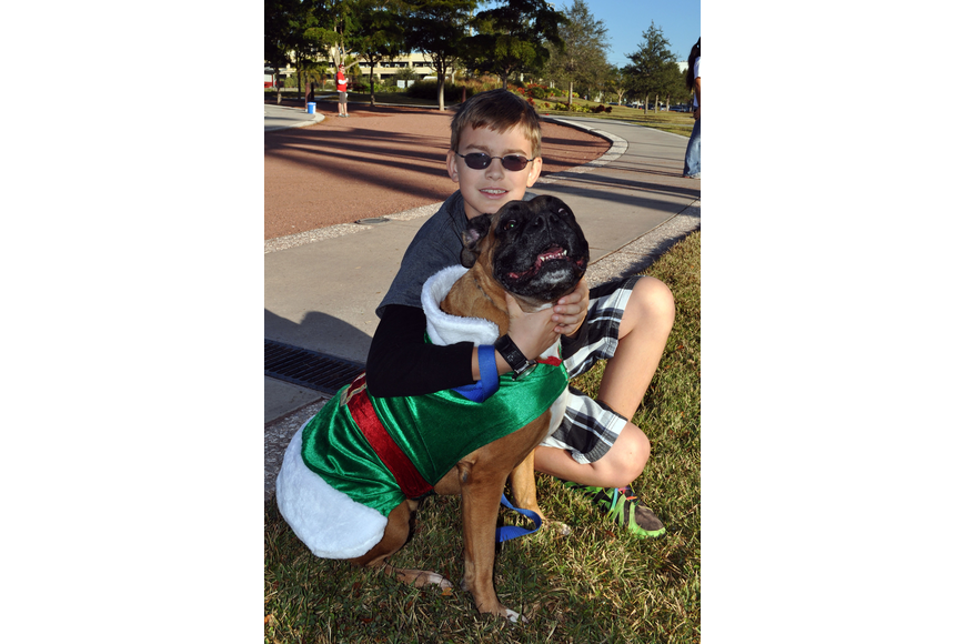Ryan Mandia, 11, with his dog, Bandit.