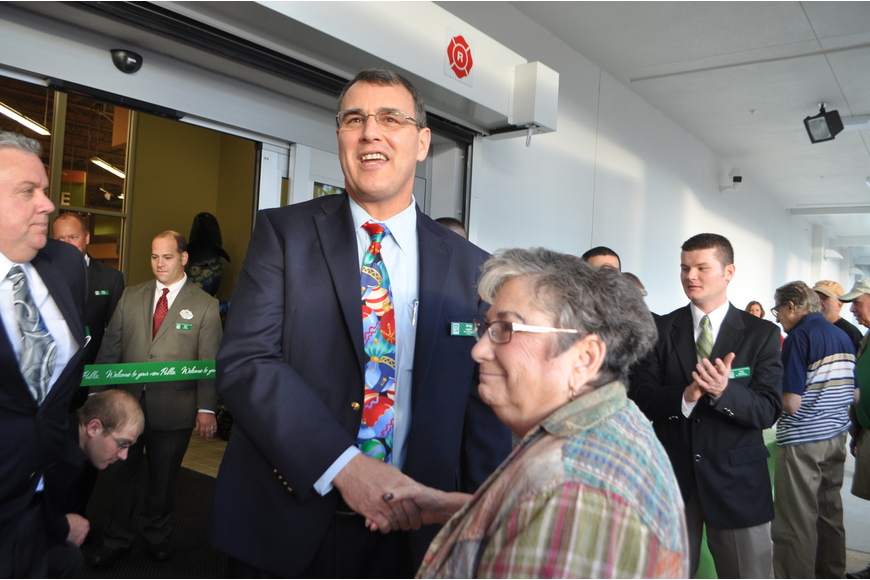Store manager Andy Lappin greets Joan Sinder, who was the first customer to walk through Publix doors.