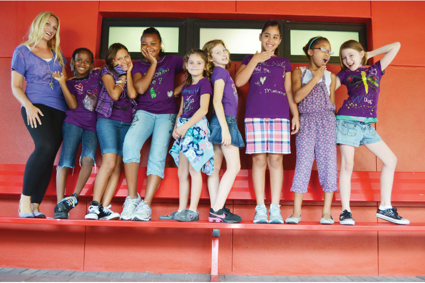 Emily Harris, Kayten Rivers, Isabelle Crotsley, Sheridan Jules, Alyssa Currier, Bianca Butrum, Montserrat Vazquez, Shaniya Lane and Daidge McKittrick of Girls Incorporated WAVES club, dressed in purple to promote anti- bullying and self esteem-building.