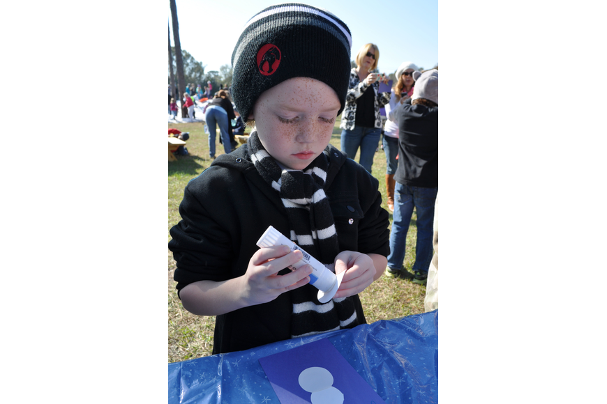 Jacob Rego, 7, decorated his snowman with a top hat, at The Tabernacle's Winter Wonderland.