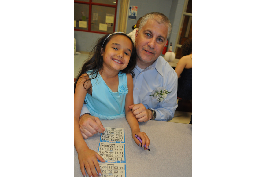 Micaela Castro played bingo with her dad, Mike Giampoala