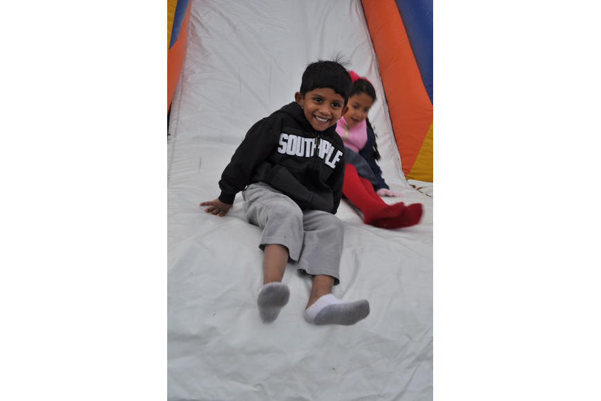 Samik Choudhury, 4, can't get enough of the slide.