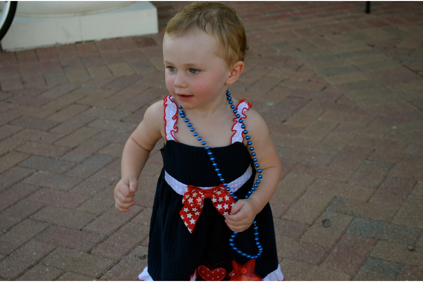 One-year-old Raelyn Dine dances to the music.