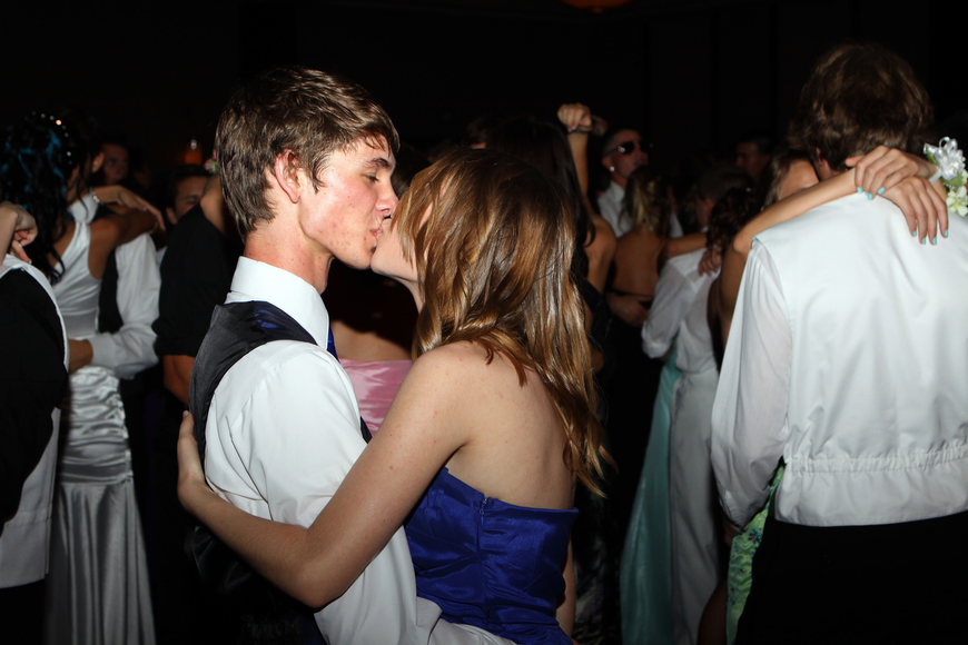 Anthony Alessandrini and Jennifer Serviss share a quick kiss while dancing to a slow song Saturday, May 14 at the Sarasota High School's prom at the Hyatt Regency.