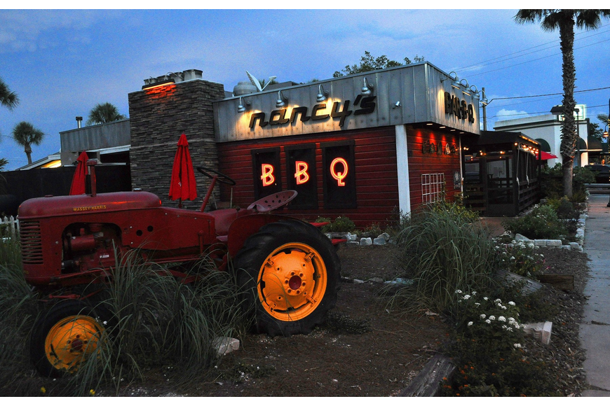 Nancy's BBQ lights up the intersection of Pineapple and Cross at night Thursday, June 23 in the Pineapple Historic District.