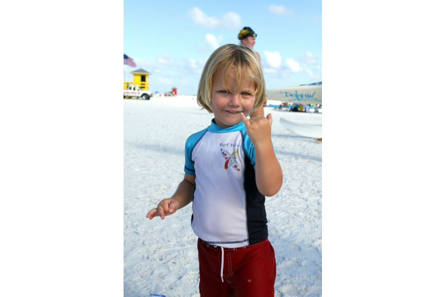 Drew Ritchie, 3, of Vero Beach, shows off his surfer dude hand signal Thursday, July 14 while watching his dad compete in the 2011 James