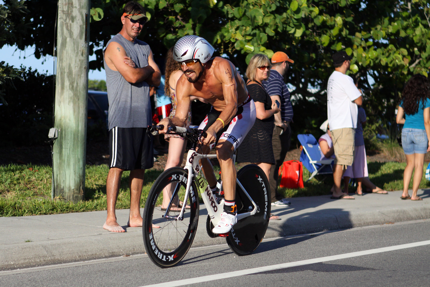 Roger Travis bikes down Beach road as part of his duathlon race. He placed first in his division and 9th overall.