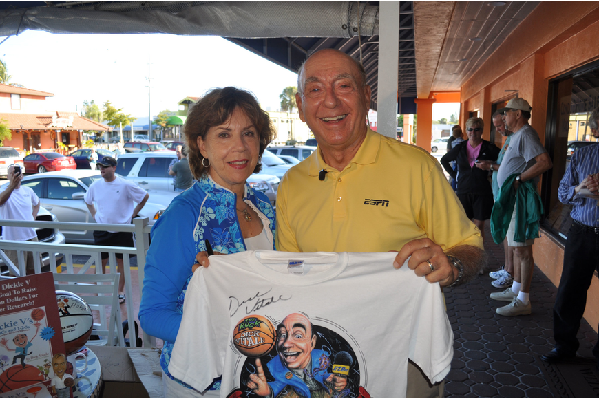 Lorraine and Dick Vitale pose with one of his autographed shirts.