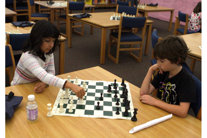 Frida Salinas-Herrera makes a move during her game against Jonathan Witte, Saturday, Feb. 11, in the library at Phillippi Shores Elementary.