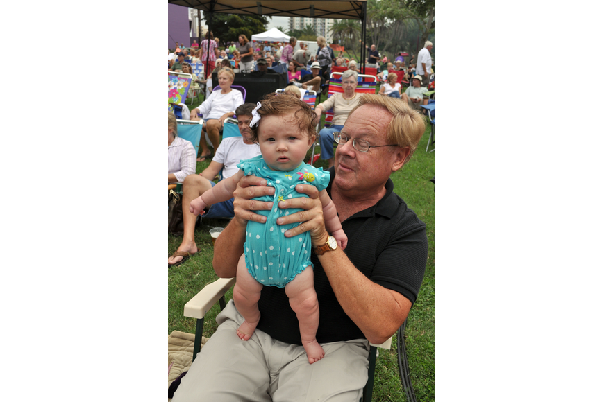 Bob Peiser helps Reagan Peiser, 4 mos., rock out to Yesterdayze, Friday, June 8, at Friday Fest.