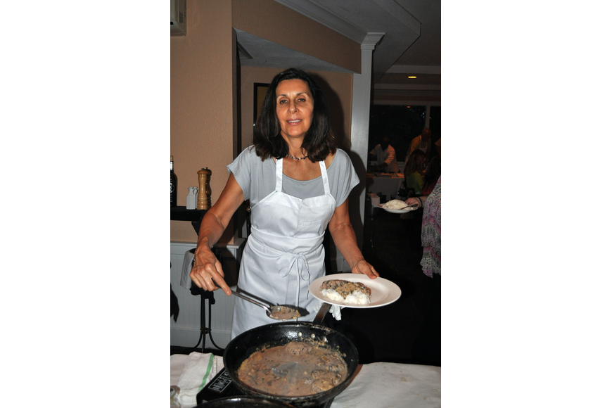 Phyllis Refi smiles as she serves up her dish, Friday, Aug. 17, at Pattigeorge's.