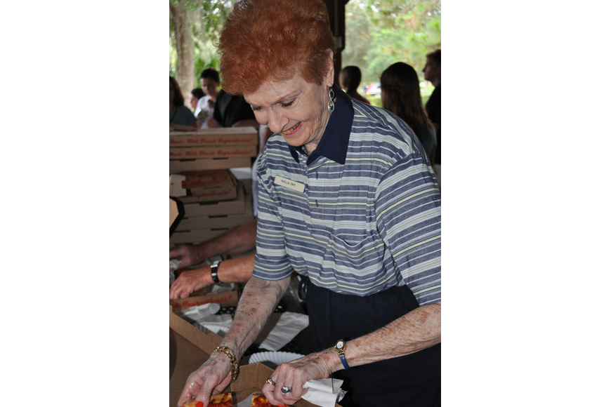 Summerfield resident Phyllis Troy serves pizza.