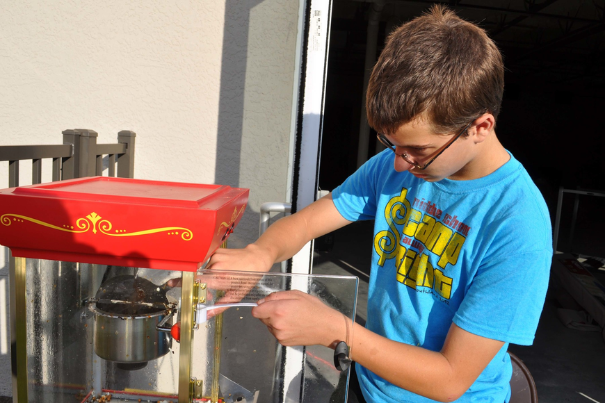 Johnny Diem, 14, made popcorn for guests.