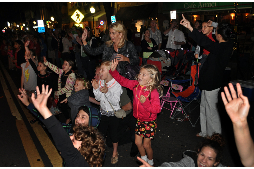 Kids scream and wave as Santa rides by Saturday, Dec. 1, during the Downtown Sarasota Holiday Parade.