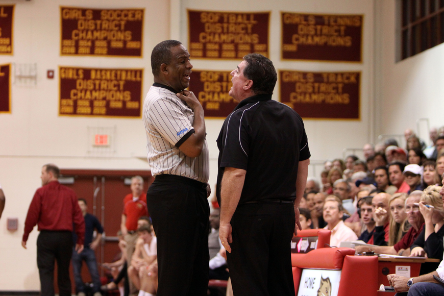 St. Petersburg Catholic's head coach Mike Moran gets into a heated argument with one of the referees during Tuesday night's semi-final game at Cardinal Mooney.