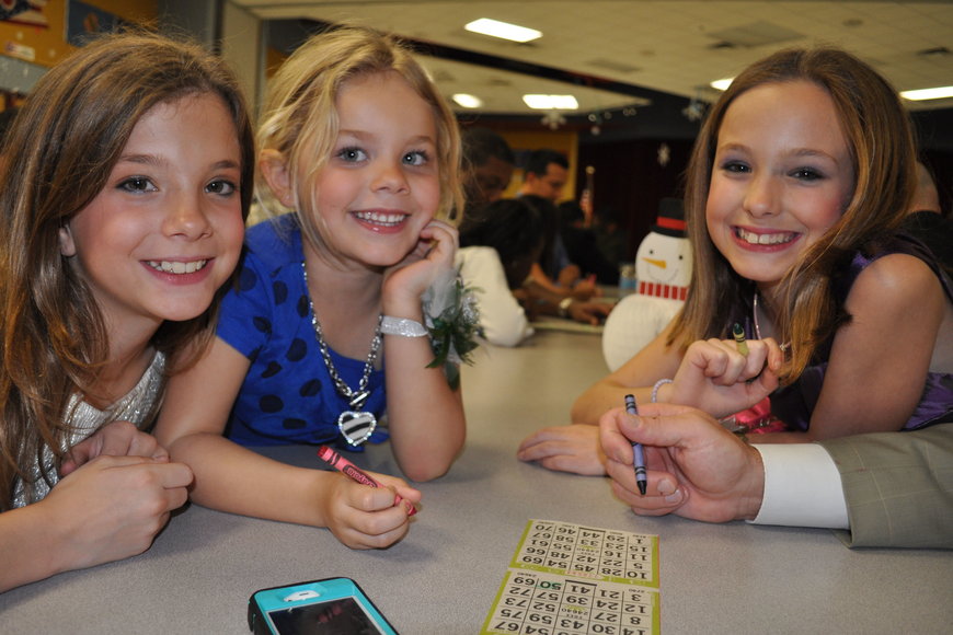 Sisters Maria Lovelace, Grace Olesen and Gina Lovelace eagerly tested their bingo skills.