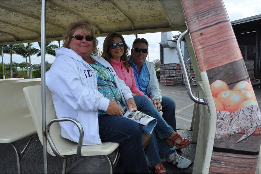 Gayle Furrow and Mary Ann and Todd Williams aboard a tram tour
