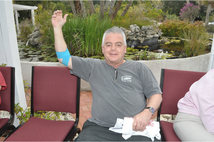 Bob McKone shows off his bandaged arm after giving blood.