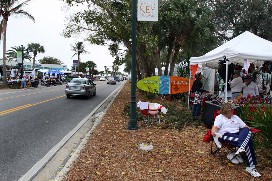 A view of the crowded sidewalks and main road in Siesta Key Village on Saturday, Feb. 5.