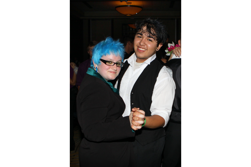 Olivia Ben-Tovim and Advichil Anzares dance together Saturday, May 14 at the Sarasota High School's prom at the Hyatt Regency.
