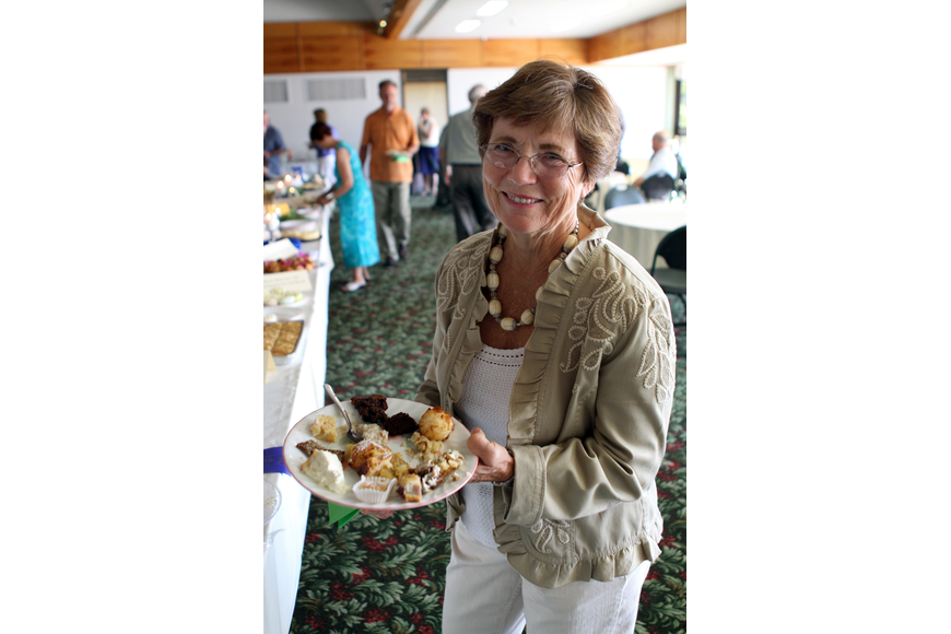 Marty Hillerich shows off her plate of desserts at Family Promises' Third Annual Just Desserts event Friday, May 20 at Selby Garden's Great Room by the Bay.