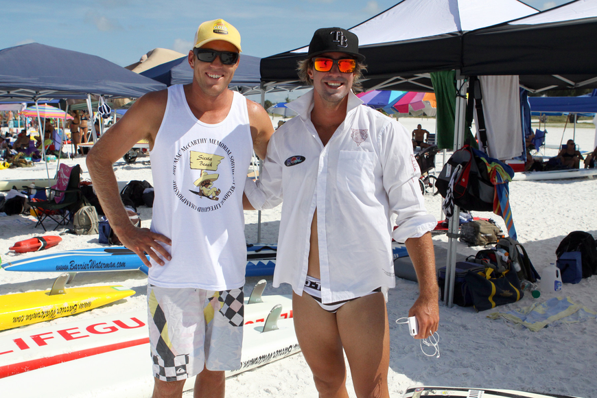Destin lifeguards Dylan Newbiggin and Luke Turner pose together Thursday, July 14 during the 2011 James