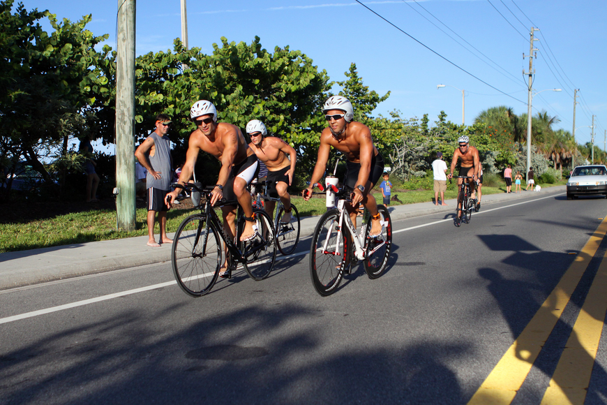 A group of triathletes made their way through the busy roads of Siesta Key Village.