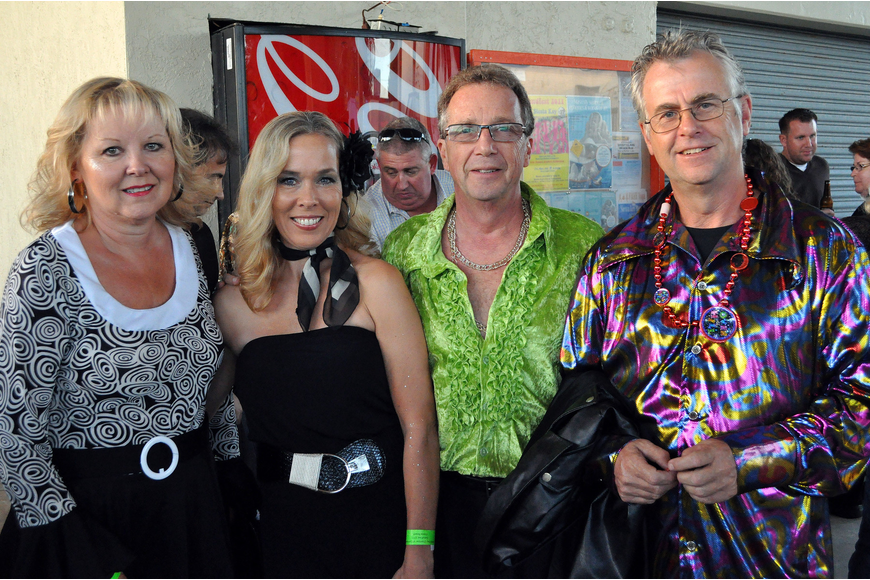 Lynn and Bob Shaffer pose between Sheila and Mike Lewis at Sandfest 2011, Friday, Nov. 4, at Siesta Key Beach Pavilion.