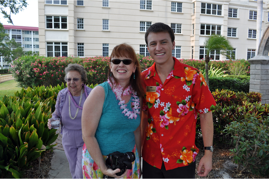 Jennifer Walker and Clayton Steranko passed out leis to residents.