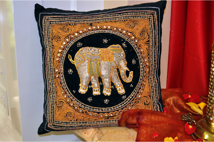 A pillow owned by Kathleen Powell that she bought in Thailand 10-years-ago was on display, Saturday, July 21, at Bird Key Yacht Club's Passage to India night.