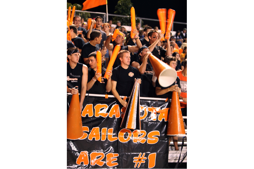 Sarasota High students cheer from the stands at Ihrig Field Friday, Oct. 26, during the Riverview High School versus Sarasota High School football game.