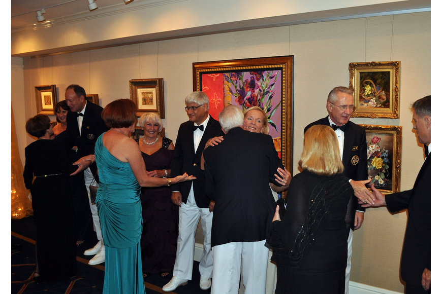 The commodores and their wives lined up in the hall as part of a receiving line Saturday, Nov. 17, during Bird Key Yacht Club's Commodore's Ball.
