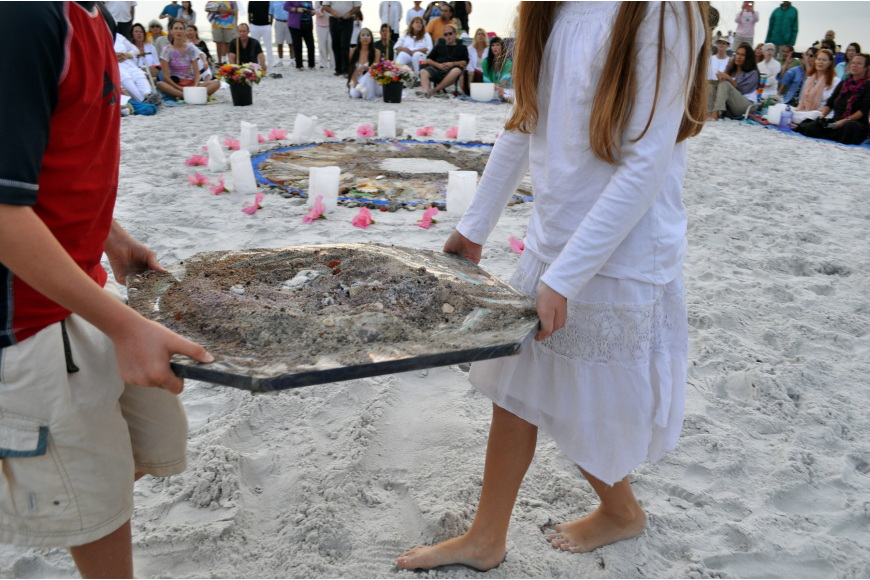 Gabriel and Ella Mirman walked around the circle with a pile of the mixed sand Wednesday, Dec. 12, during the 12.12.12 Sands of the World Mandala on South Lido beach.