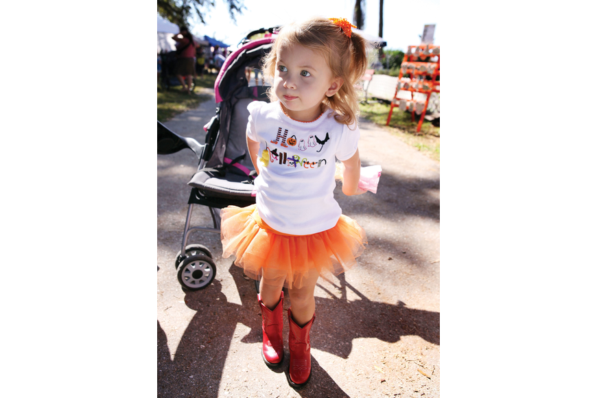 "Samantha Chessler, 2, had fun wearing a ""Happy Halloween"" shirt, orange tutu and red cowgirl boots at the 24th annual Pumpkin Festival at Fruitville Grove."