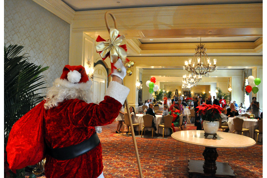 Santa makes his way to the breakfast to see the children anxiously waiting to sit on his lap.