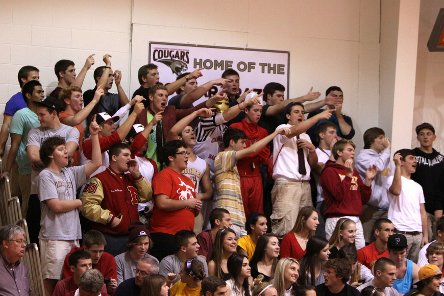 Students from Cardinal Mooney try to distract St. Petersburg Catholic's players while cheering on Cardinal Mooney's players during Tuesday night's semi-final game.