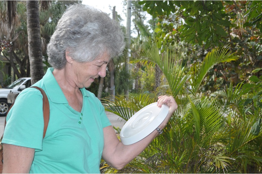 Donna Pullian checks out a plate.