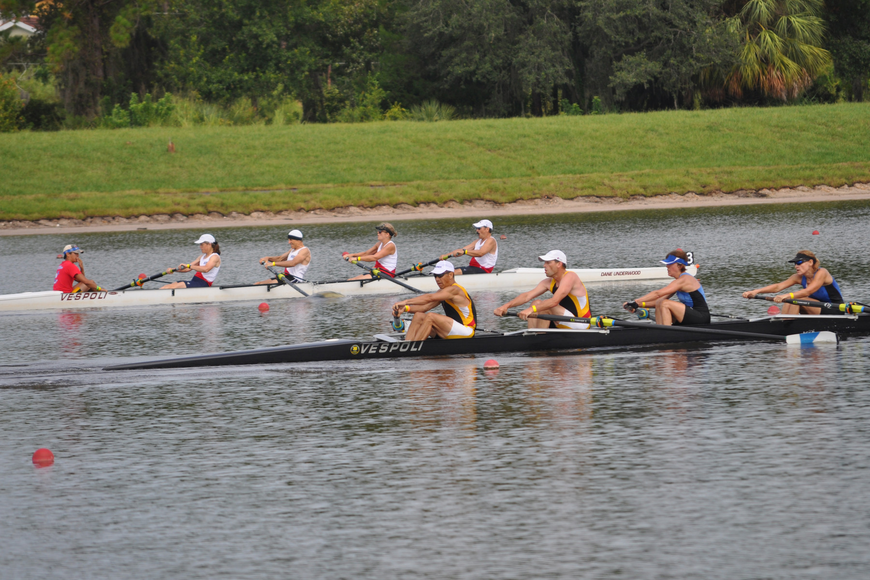 Competitors in the mixed 4s race toward the finish line.