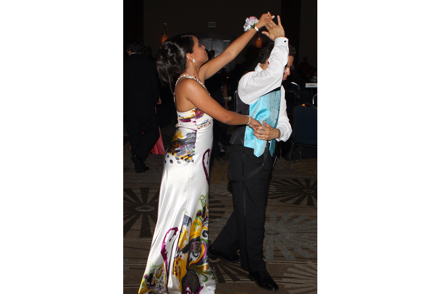 Maria Arrate and Julian Betancar do some ballroom dancing off the dance floor Saturday, May 14 at the Sarasota High School's prom at the Hyatt Regency.