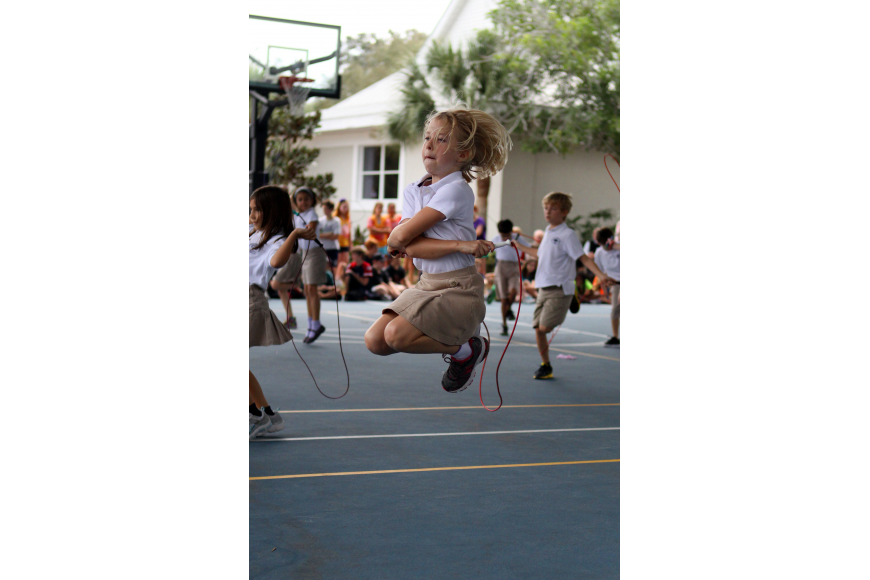 Ansley White get some air and shows off some fancy jump roping skills during the Jump Rope for Heart event on Friday.