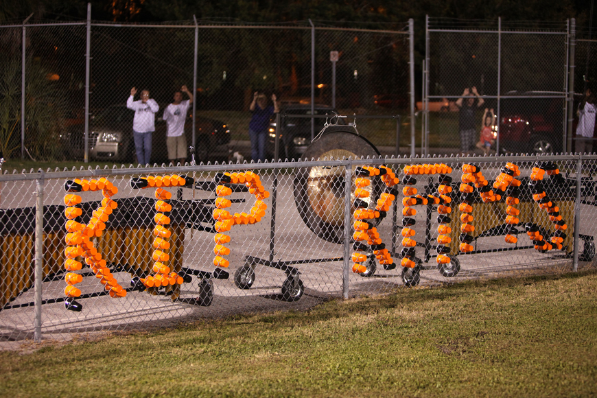 "Orange and black cups spelled out ""RIP RAMS"" in the fence surrounding the field Friday, Oct. 26, during the Riverview High School versus Sarasota High School football game."