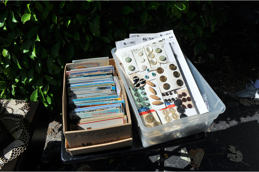 Boxes filled with old postcards and antique buttons.
