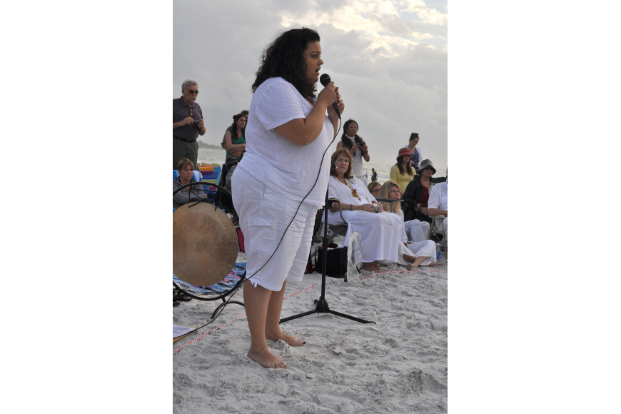 "Martha Lopez, a soprano with the Sarasota Pops, sand ""Let there be Peace on Earth""."