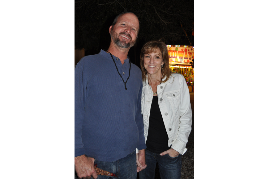Lyle and Kristen Whidden reminisced as they saw a ride their children used to love.