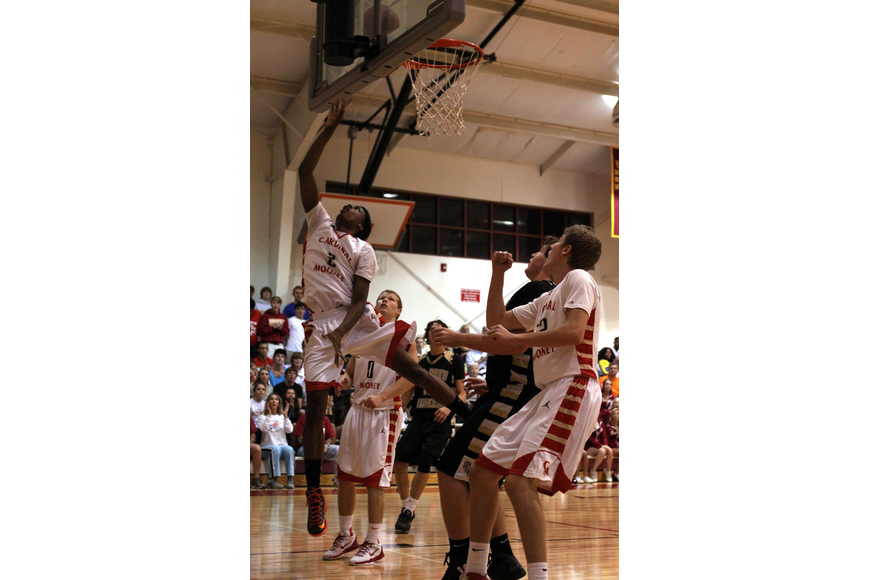 Cardinal Mooney's Antonio Blakeley, No. 2, shoots a lay up and scores for Cardinal Mooney.