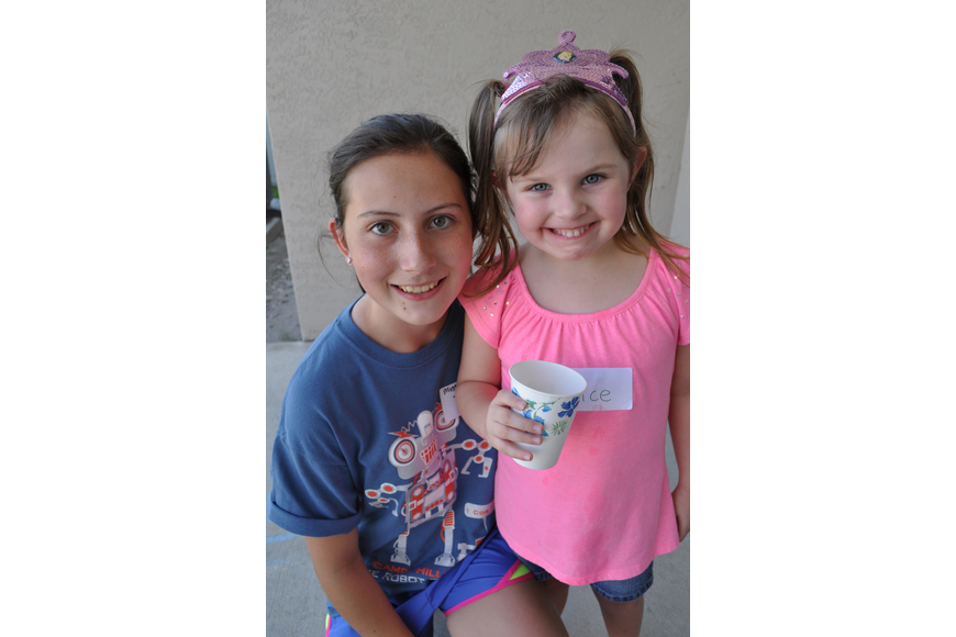 Counselor Taylor Wolf gets a smile from Alice Barr, 4.